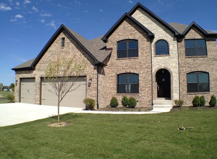 Front exterior view of a custom home using the Karson floorplan