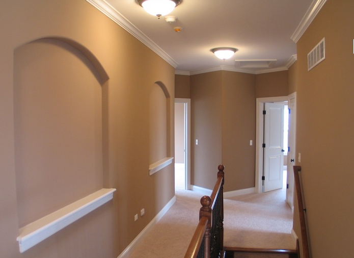 Second floor hallway and staircase in the Jonathan I floorplan from DJK Custom Homes